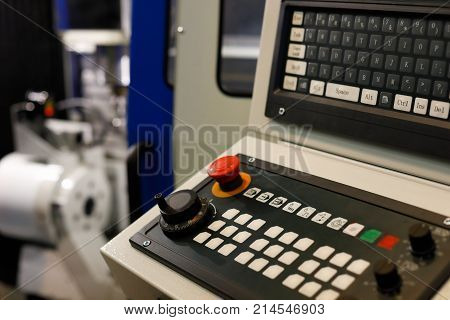 Keyboard on a control panel of CNC metalworking machine. Selective focus.