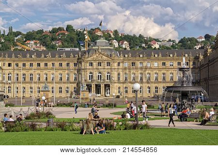 STUTTGART, GERMANY - AUGUST 18, 2017: The Neue Schloss(New Castle)  The New Castle is in the center of Stuttgart near the shopping mile Königstrasse and the park in front of it is used for relaxing.