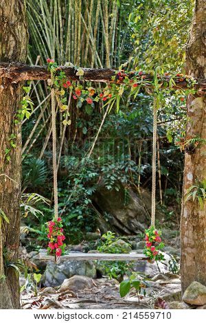Wedding Pergola Seesaw Lonely Swing Decorated With Flowers At Garden