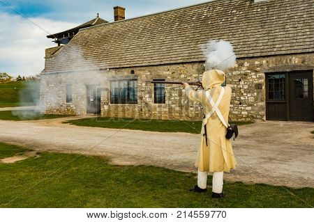 A Colonial Soldier demonstrating how to fire a Musket.