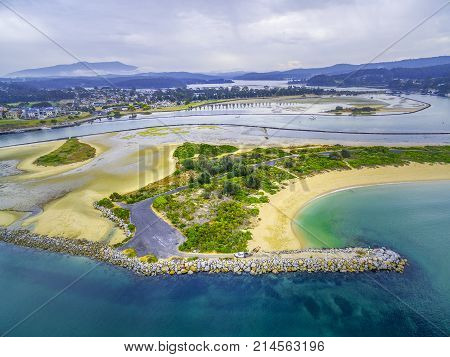 Aerial view of beautiful Narooma inlet - residential buildings shallow water. NSW Australia