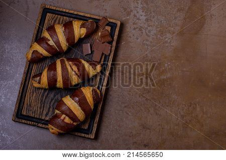 Chocolate Croissant And Chocolatier On Table