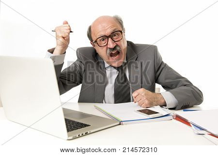 senior mature business man with bald head on his 60s working stressed and frustrated at office computer laptop desk looking tired and overwhelmed in job problems and overwork concept