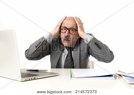 senior mature busy business man with bald head on his 60s working stressed and frustrated at office computer laptop desk looking tired and overwhelmed in job problems and overwork concept