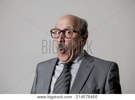 portrait of 60s bald senior happy business man gesturing funny and comic in laughter and fun face expression looking happy and cheerful isolated on grey background in satisfied worker or director concept poster