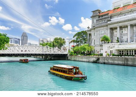 Scenic View Of Tourist Boats Sailing Along The Singapore River