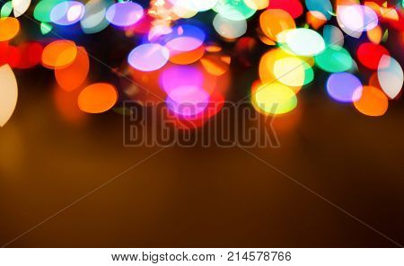 Color light blurred background, unfocused. Christmas or other holiday decorations, garland illumination bokeh, copy space