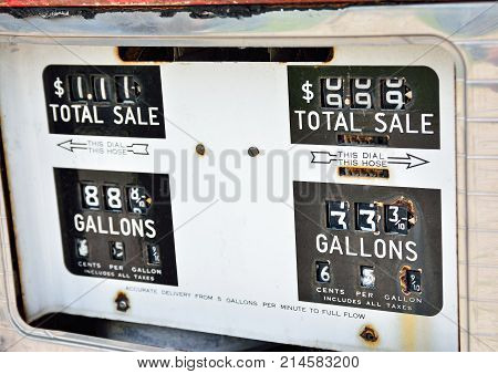 Old rusty american gas pump panel displaying the price in dollars and filling amount in gallons