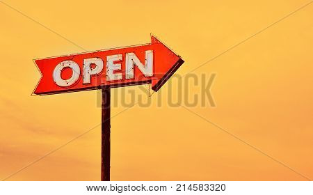 Open Neon Sign At Sunset.