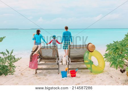 family beach vacation- family with kids on tropical beach vacation
