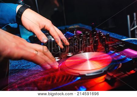 DJ mix music hands on professional music equipment for CDs with buttons and controllers with light effects
