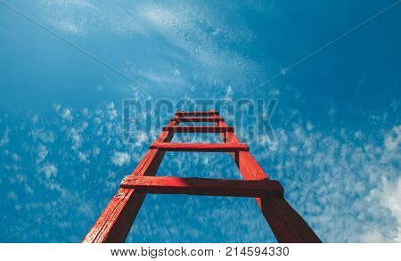 Red Staircase Rests Against Blue Sky Front View. Development Motivation Career Growth Concept
