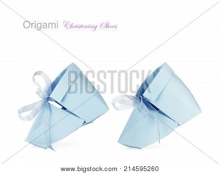 Paper baby boy christening shoes on a white background