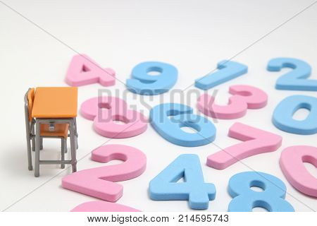 Numbers and desk on white background. Educational concept of mathematics and arithmetic.