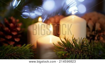 4K Beautiful Long CloseUp of Lighted White Candles with F Christmas Ornament as Decor on Eve in Slow Motion