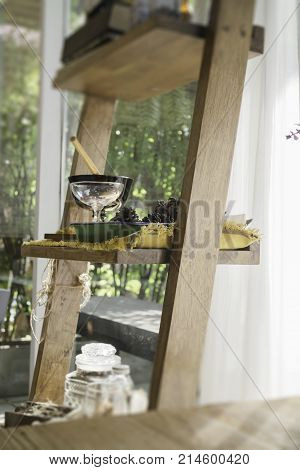 Stepladder with seed and dry herbs room decoration stock photo