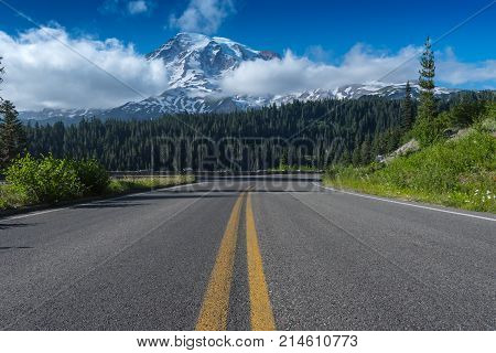 Road Leading Toward Mount Rainier with clouds hovering low in sky