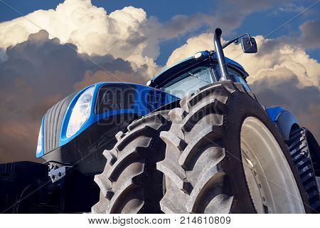 Tractor working on the farm, a modern agricultural transport,  tractor at sunset, modern tractor closeup