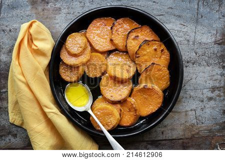 Candied yams, or sweet potatoes.  Top view over wooden table.