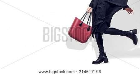 Fashion Model girl full length portrait on white background. Beauty stylish woman wear woman posing in fashionable clothes in studio. Winter fashion, black coat, trendy bag and shoes, Casual style.