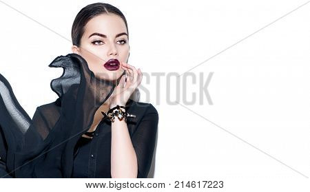 Beauty Fashion model girl with dark lips portrait, wearing stylish chiffon dress. Sexy woman portrait with perfect makeup and manicure, trendy accessories and fashion wear. Beauty trends. On white.