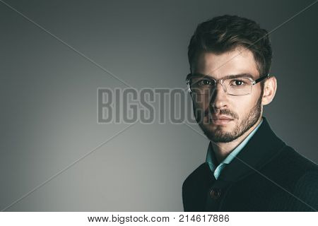 Elegant man in glasses. Optics style for men. Handsome businessman in spectacles. Male beauty, fashion. Copy space.