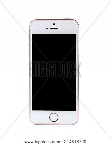 KIEV, UKRAINE - OCTOBER 6, 2017: Front view of Rose Gold iPhone SE on white background