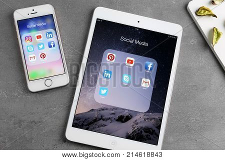 KIEV, UKRAINE - OCTOBER 03, 2017: iPad mini 4 and iPhone SE with social media icons on screens