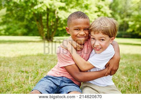 Two kids as friends fighting with each other for fun