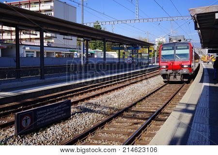 GENEVA, Switzerland - 7 July, 2016: A passenger train of the Swiss Federal Railways at a platform of the Aarau railway station. Swiss Federal Railways is the national railway company of Switzerland