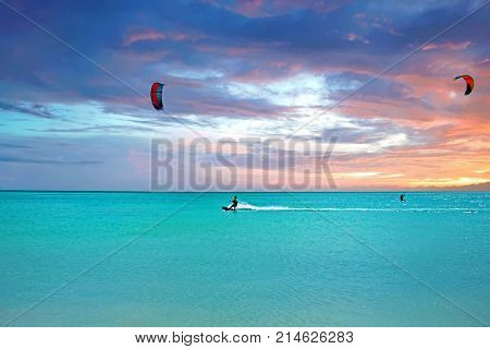 Kite surfing at Aruba island in the caribbean sea at sunset
