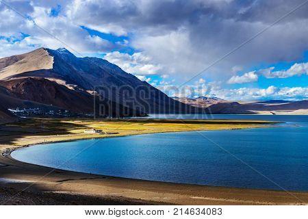 Panorama of Himalayan lake Tso Moriri and Korzok village in Himalayas on sunset, Ladakh, India