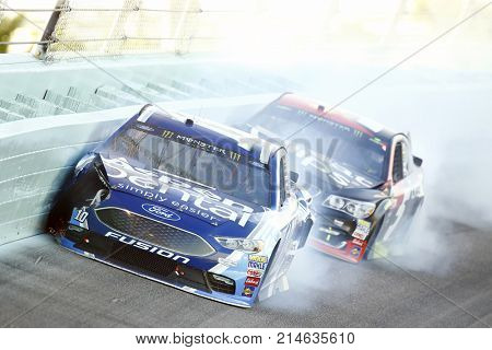 November 19, 2017 - Homestead, Florida, USA: Danica Patrick (10) and Kasey Kahne (5) wreck to bring out a caution during the Ford EcoBoost 400 at Homestead-Miami Speedway in Homestead, Florida.