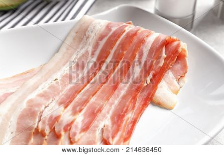 Rashers of bacon on plate, close up