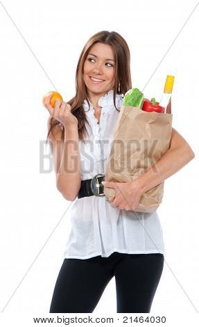 Happy Young Woman Holding A Shopping Bag Full Of Groceries,