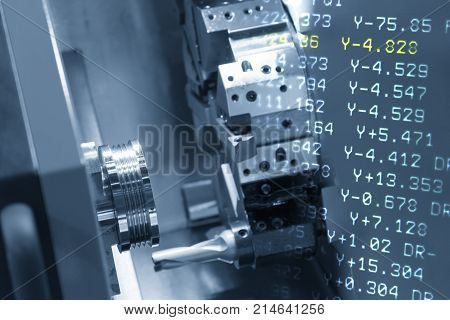 The abstract scene of CNC lathe machine (Turning machine) and NC code.Hi-precision CNC machining concept.