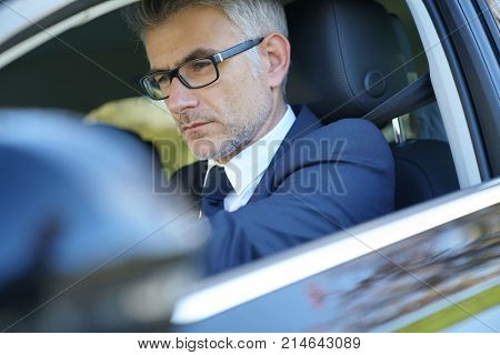 Private taxi driver driving fancy car