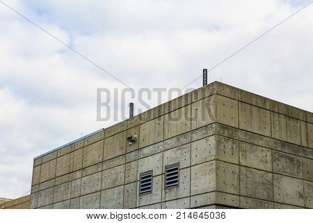 Exterior of a formed concrete slab building with side vents horizontal aspect