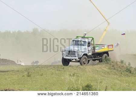 Trucks Racing On Unpaved Track. Tyumen. Russia