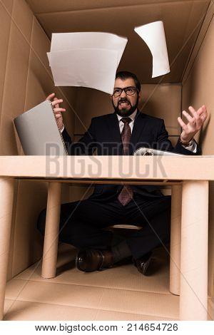 Businessman Throwing Documents