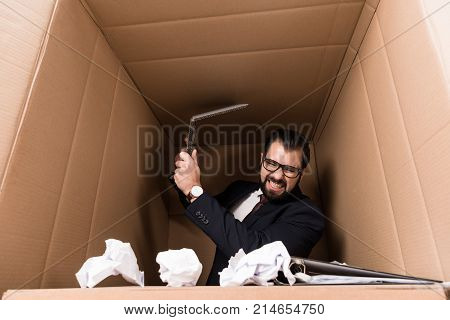 Businessman With Paperwork And Cardboard Laptop