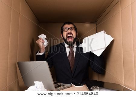 Angry Businessman With Paperwork