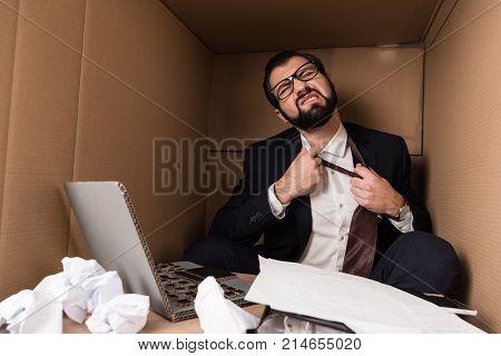 Businessman Removing Tie