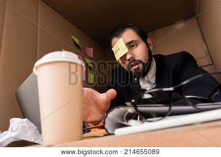 Businessman With Sticky Note And Coffee