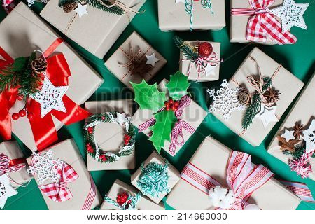 Christmas craft boxes decorated in vintage and natural style, top view with copy space