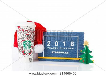Chiang Mai Thailand- 18 November 2017 - Starbucks Coffee paper cup in beautiful 2018 Christmas design set up on display with holiday special design notebook on white background in Chiang Mai Thailand on November 18 2017