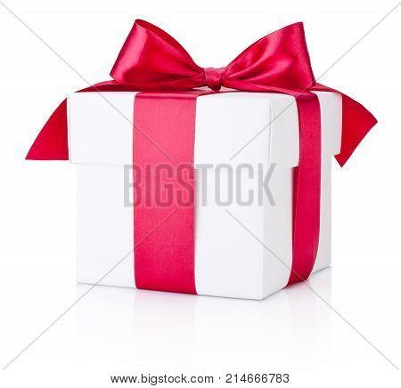 White gift box tied burgundy satin ribbon on a white background