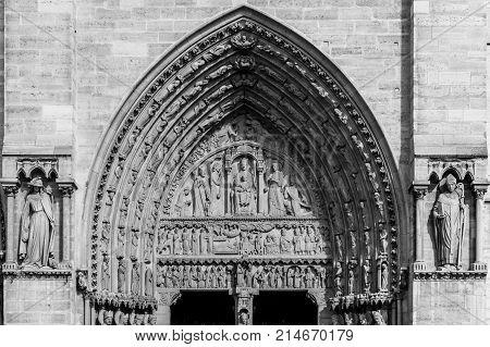 Architectural details of the catholic cathedral Notre-Dame de Paris. Built in French Gothic architecture Notre-Dame's facade showing details of the Portal of St.Anne. Paris France