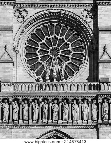 Architectural details of the catholic cathedral Notre-Dame de Paris. Built in French Gothic architecture Notre-Dame's facade showing west Rose Window and Gallery of Kings. Paris France