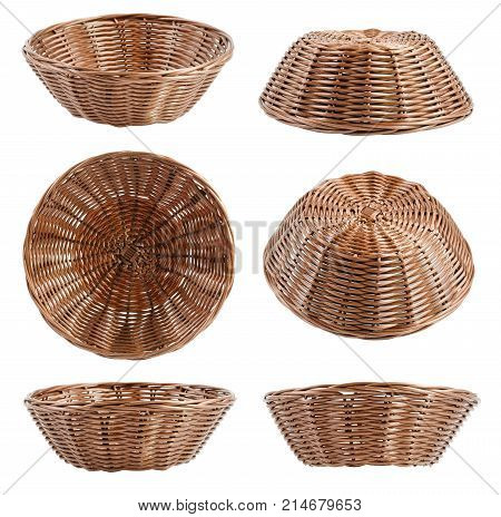 Empty brown wicker baskets at different angles isolated on white background